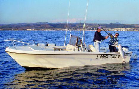 Barche da pesca open center consol for Barca a vapore per barche da pesca